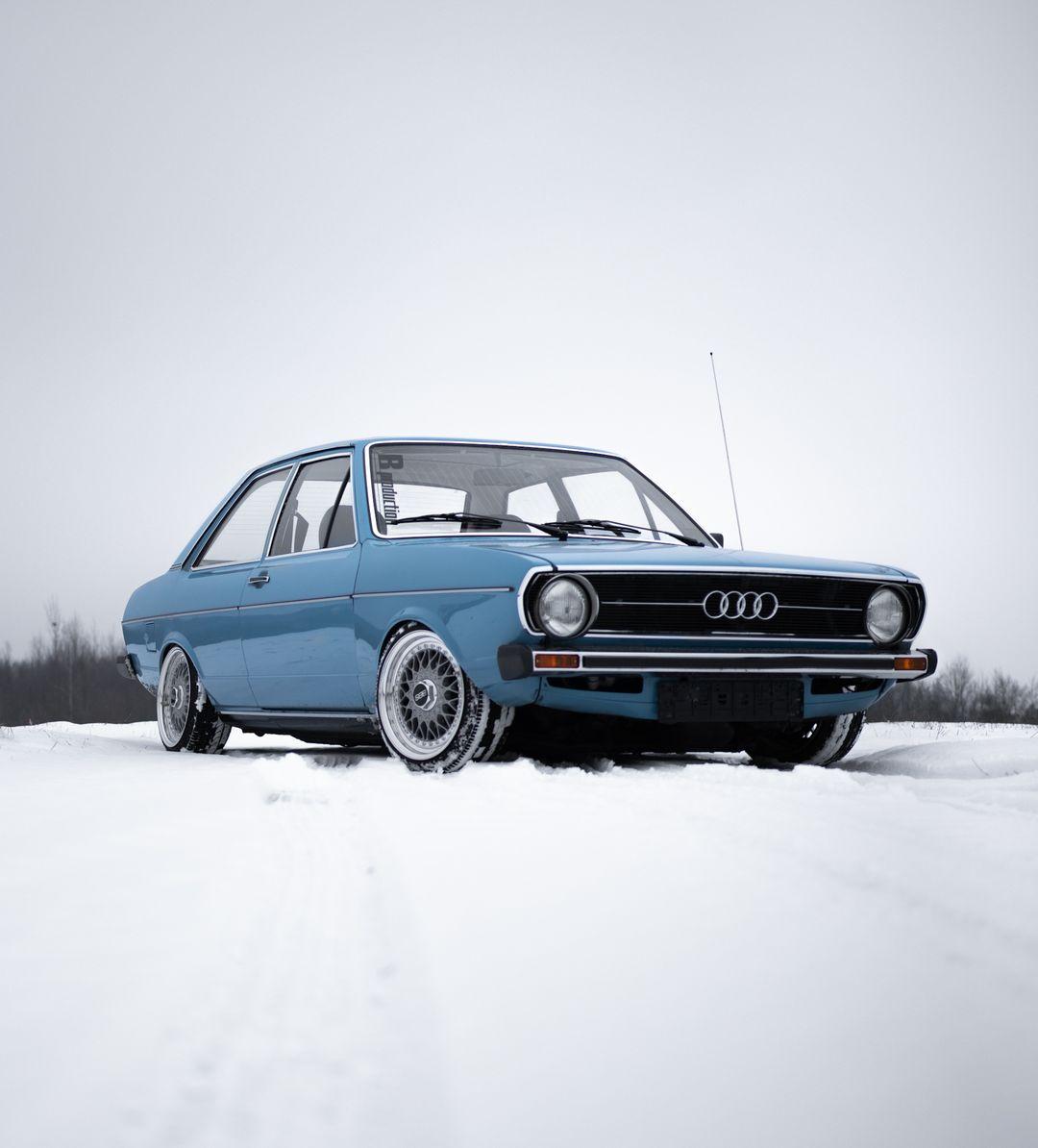 Custom Audi car in field of snow