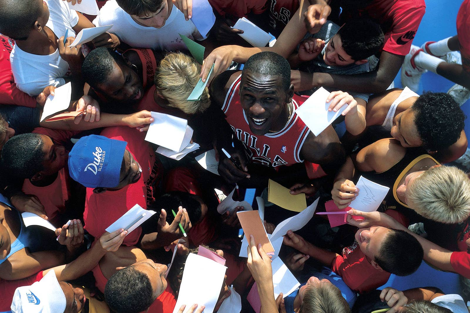 Michael Jordan signing fan cards and notes