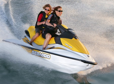girls riding a jet ski for rent from Copper Country Rentals in Calumet MIchigan