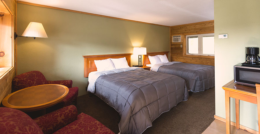 a room with two queen size beds