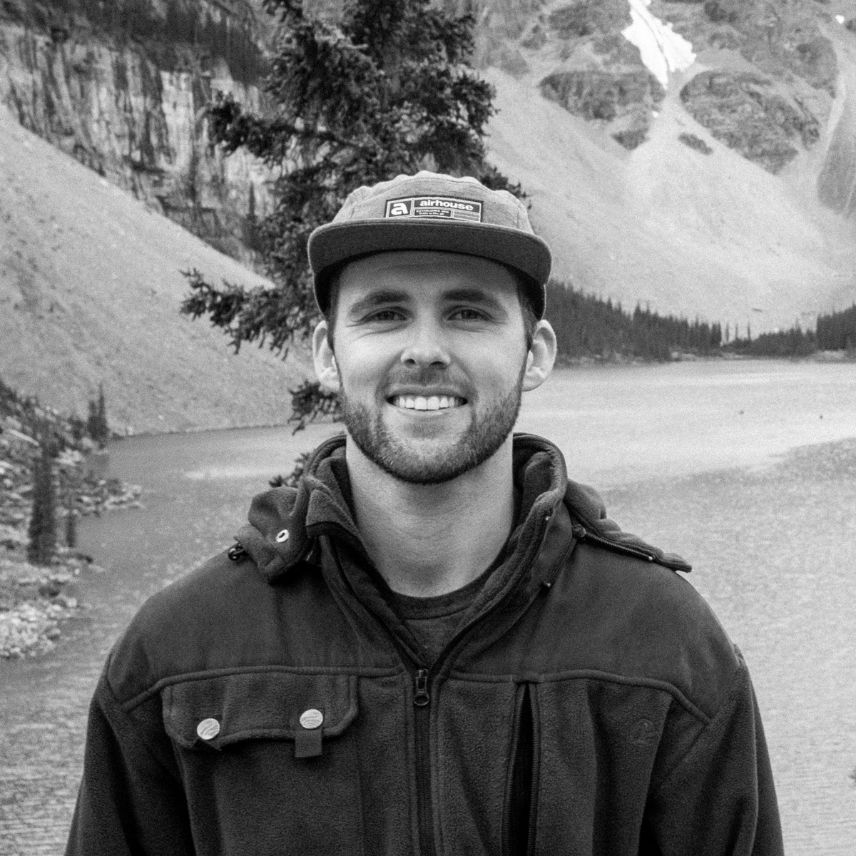 Black and white photo of a man at Moraine Lake
