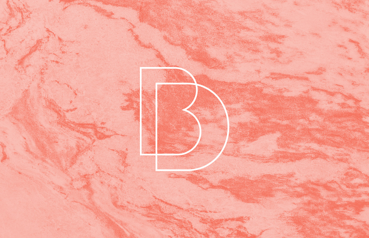Custom monogram on pink marble background