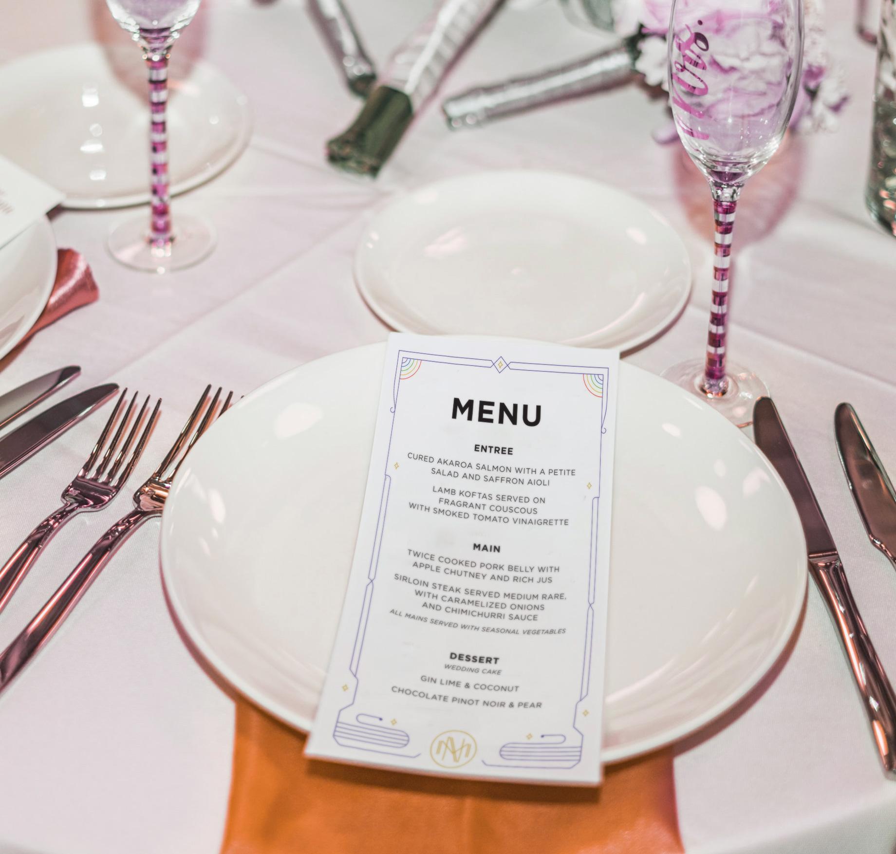 Wedding menu sitting on a plate