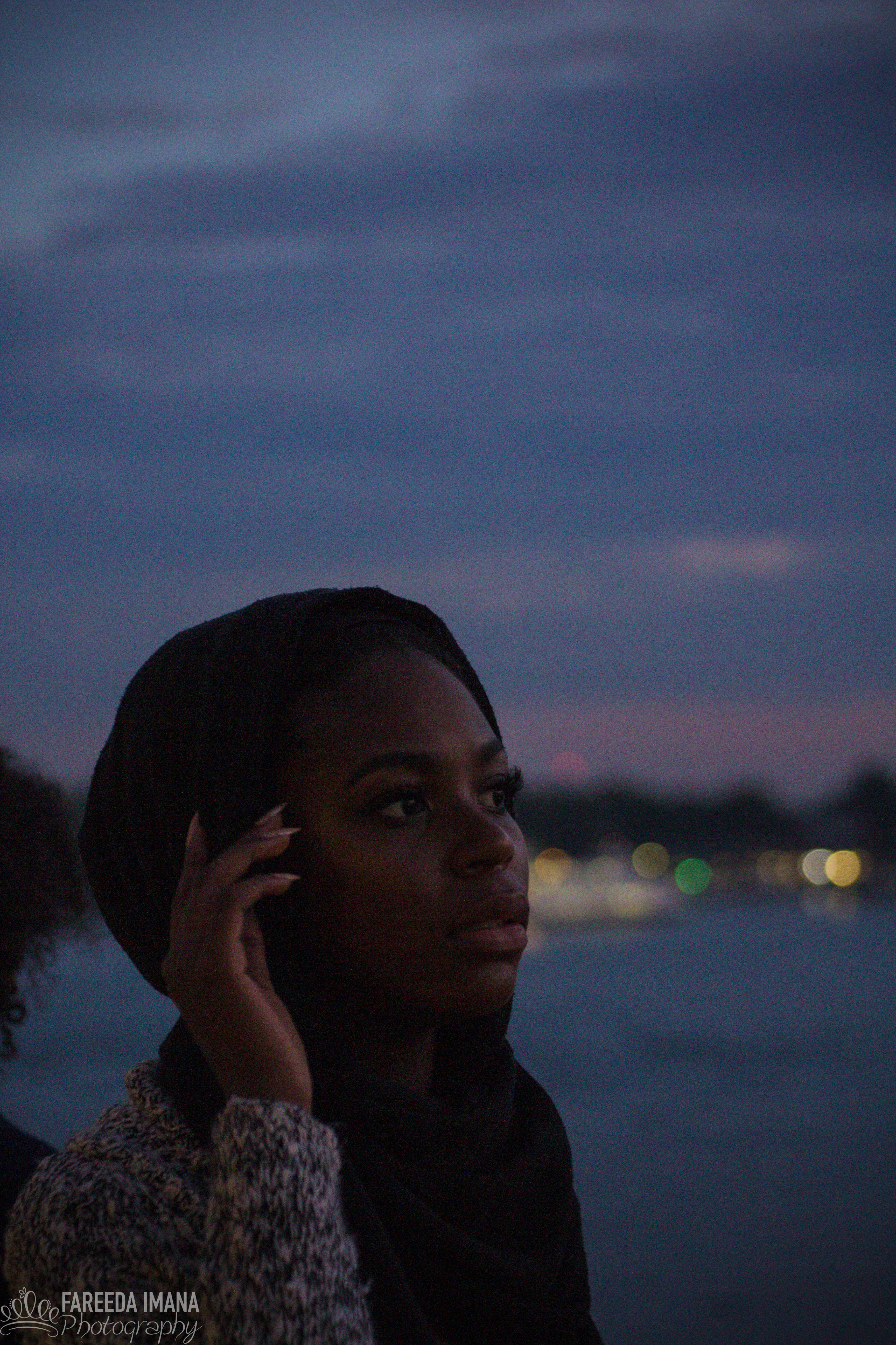 A girl looking off into the distance with a blurred background