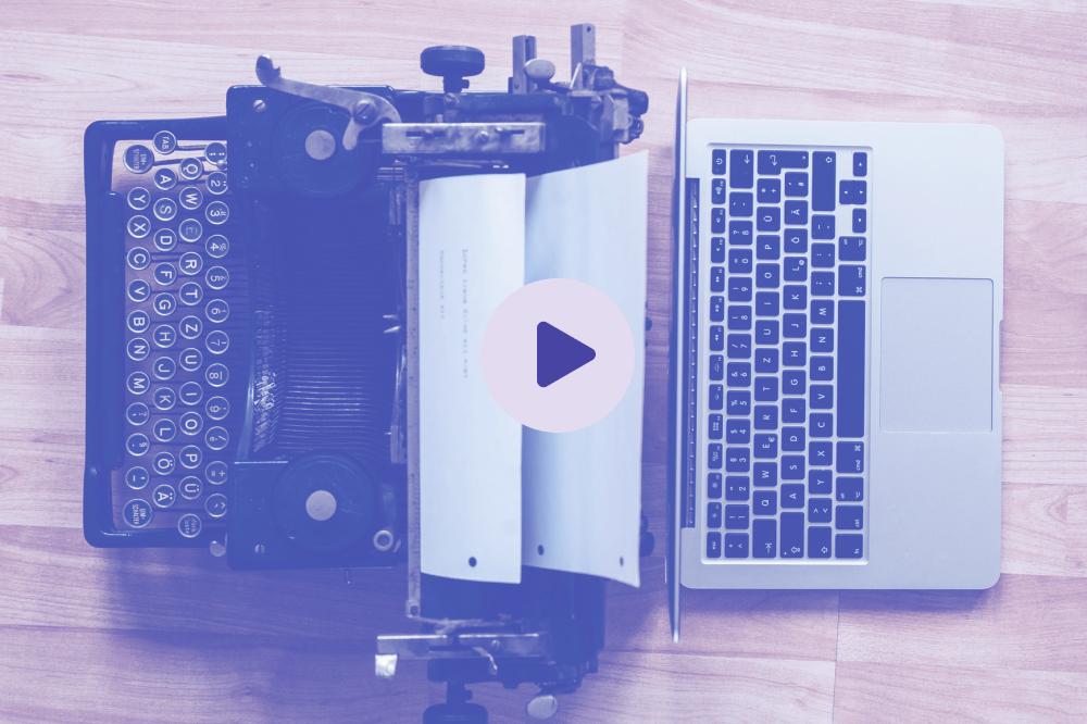 Typewriter placed behind a laptop