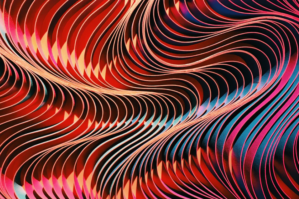 Red, black, blue and white abstract image of curving lines