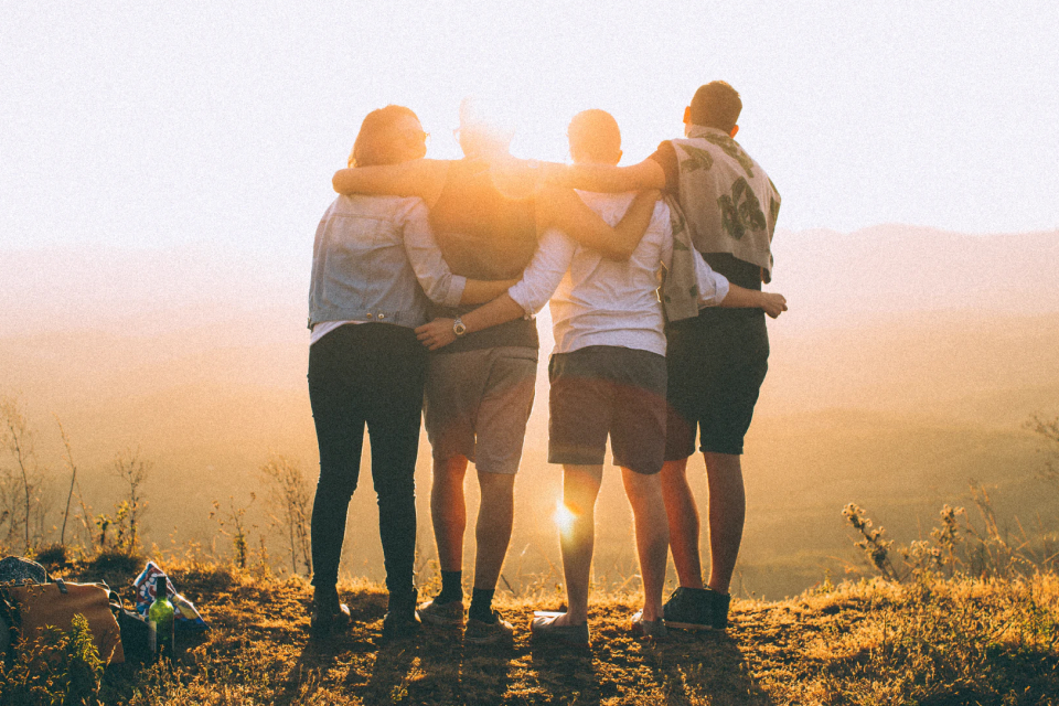 Group of friends hugging from the behind