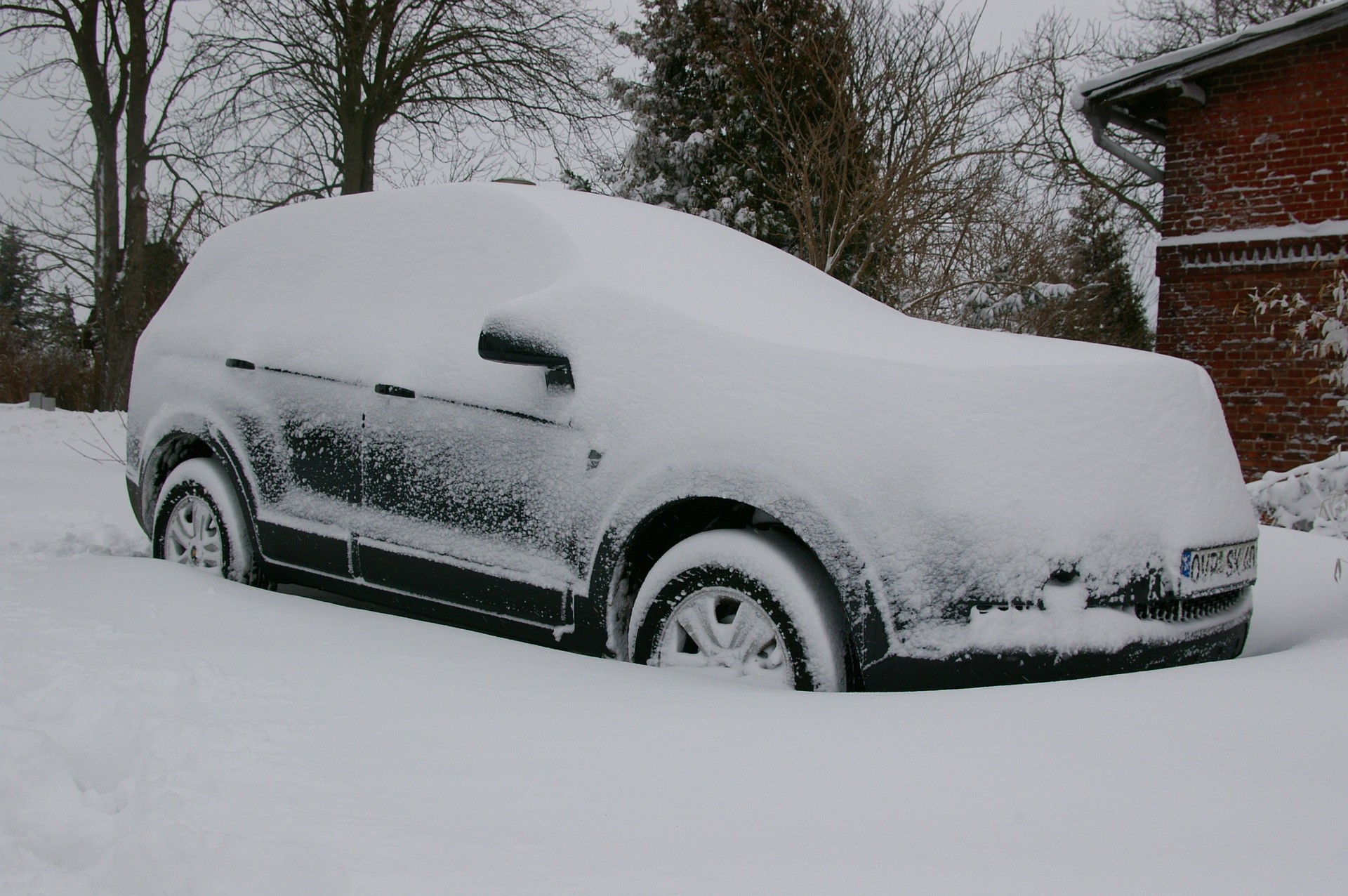 Car covered in a fresh layer of snow
