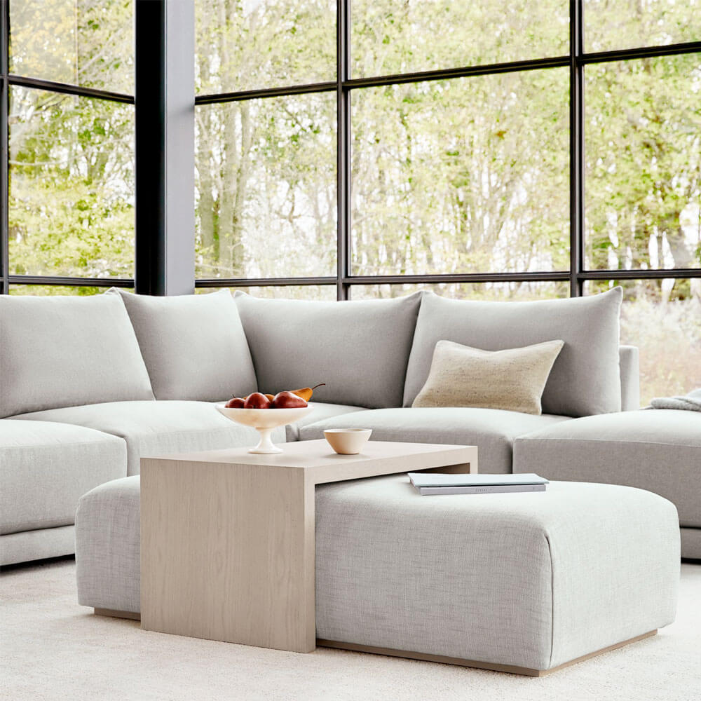 11 Ottoman Coffee Tables to Create a Cozy, Versatile Living Space
