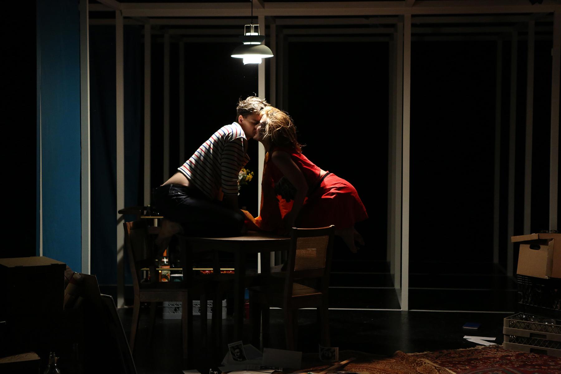 David and Gloria share a passionate kiss
