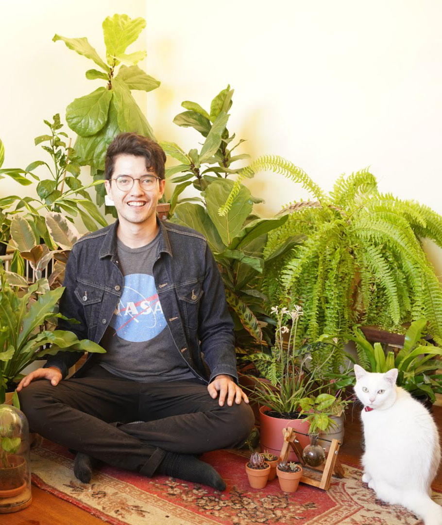 Profile photo with plants and cat