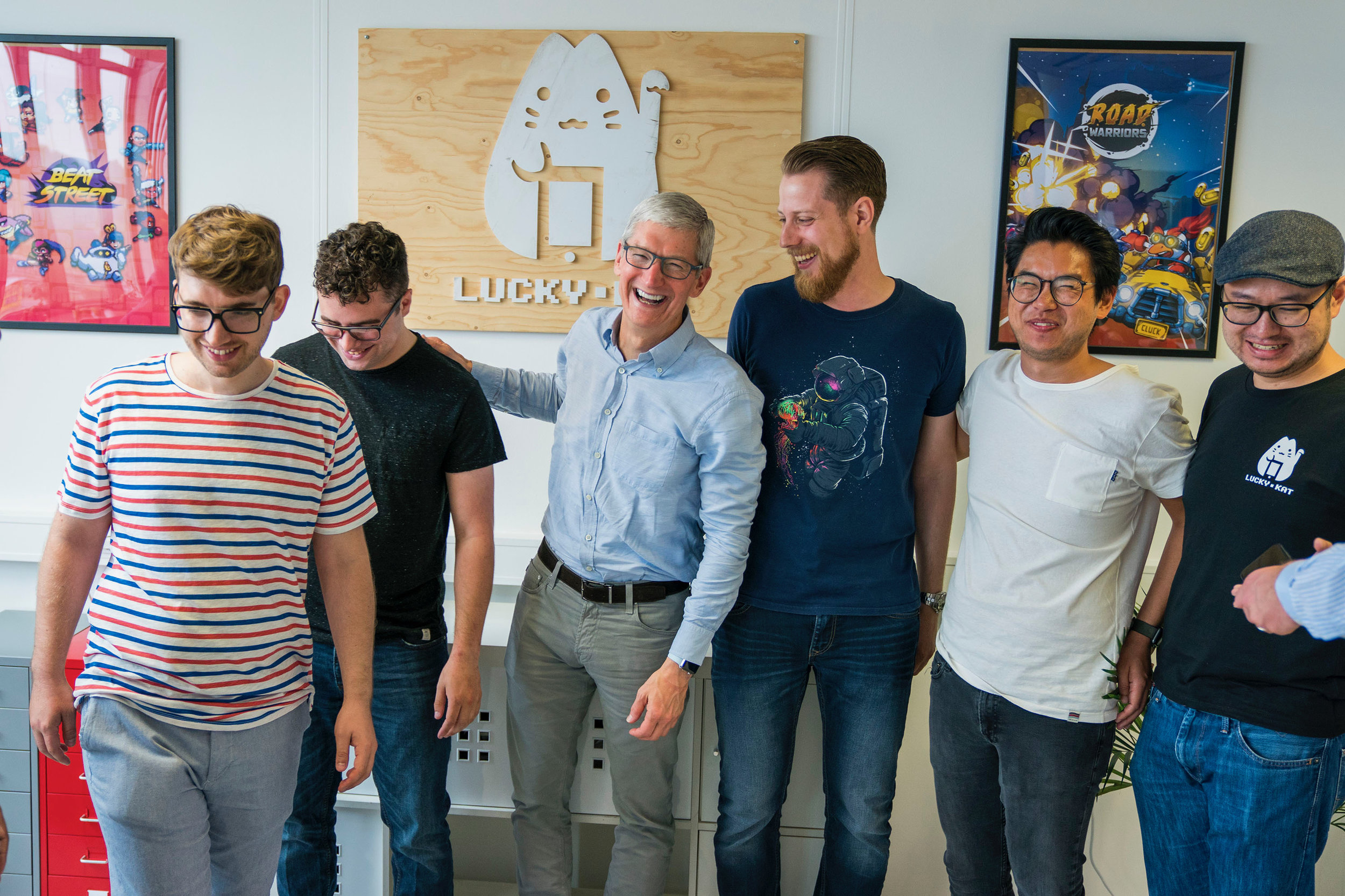 lucky cat team photo with apple's tim cook