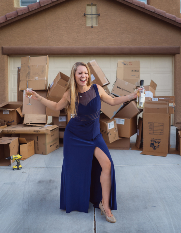 A woman celebrating being unpacked