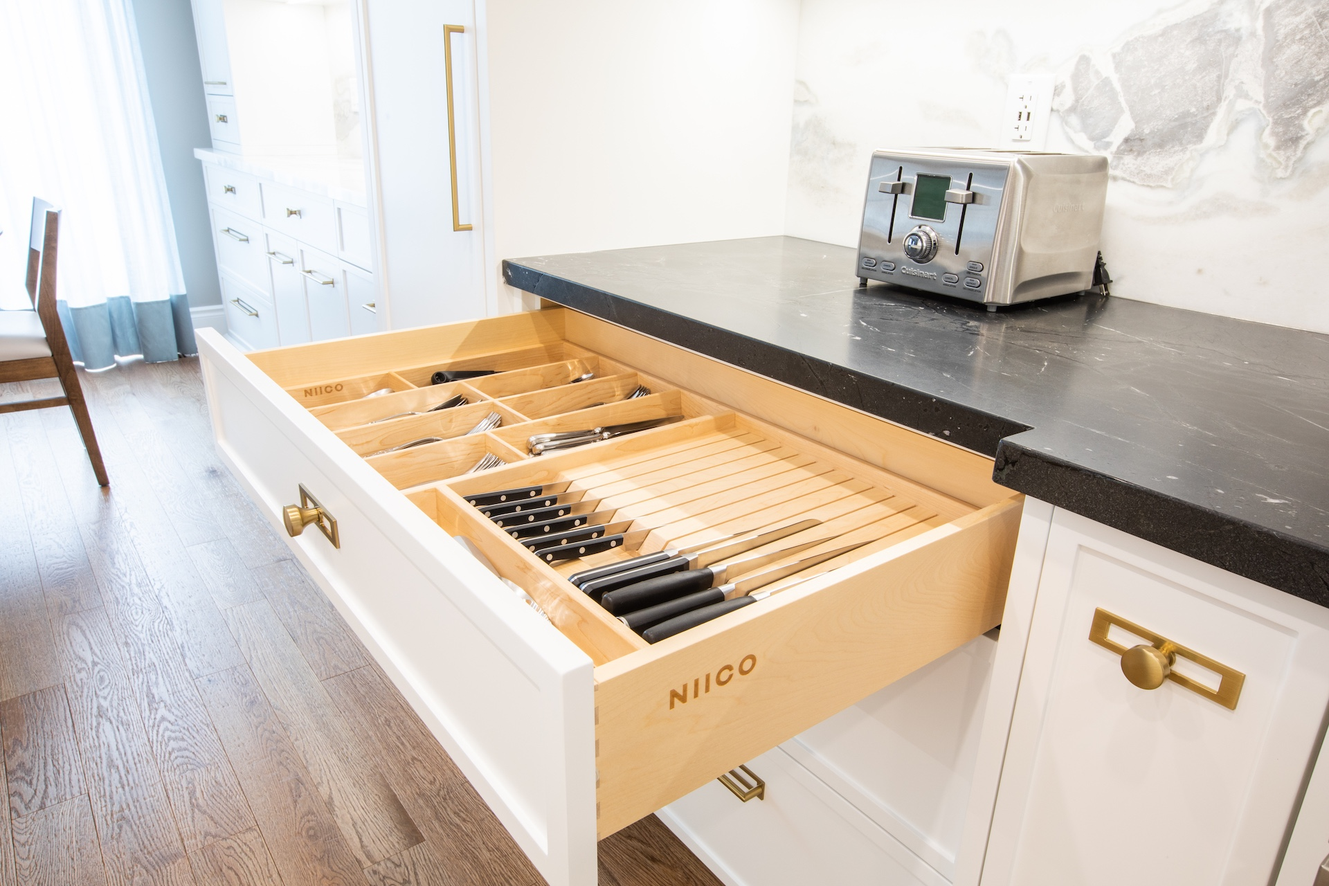 Drawer with knives and NIICO logo