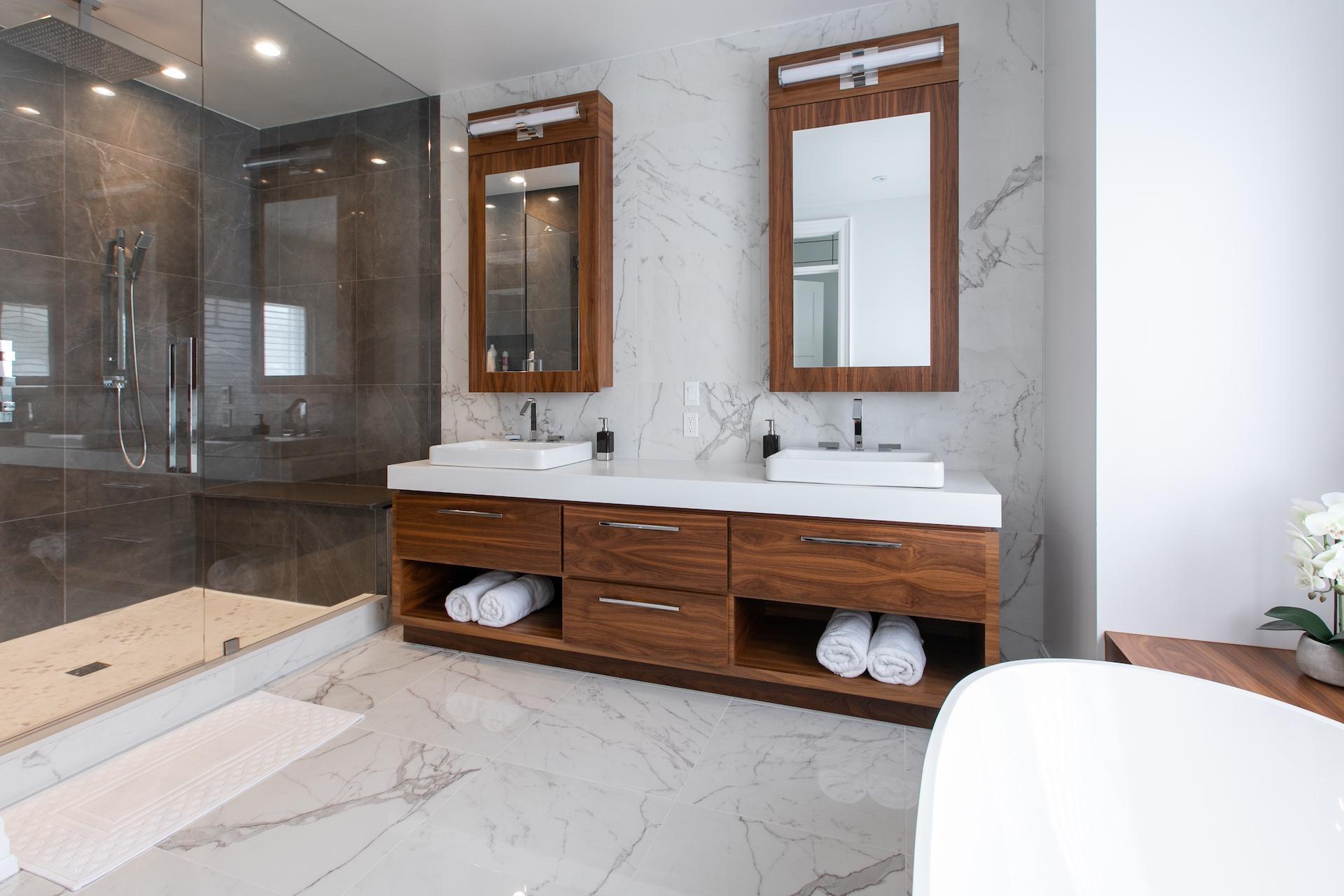 Double wood vanity with marble floors