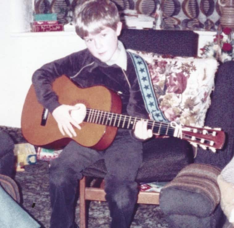 Dave age 8 playing guitar