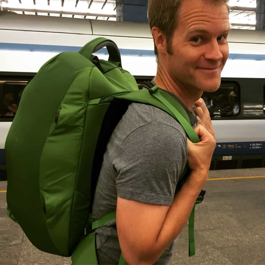 Dave carrying a green backpack