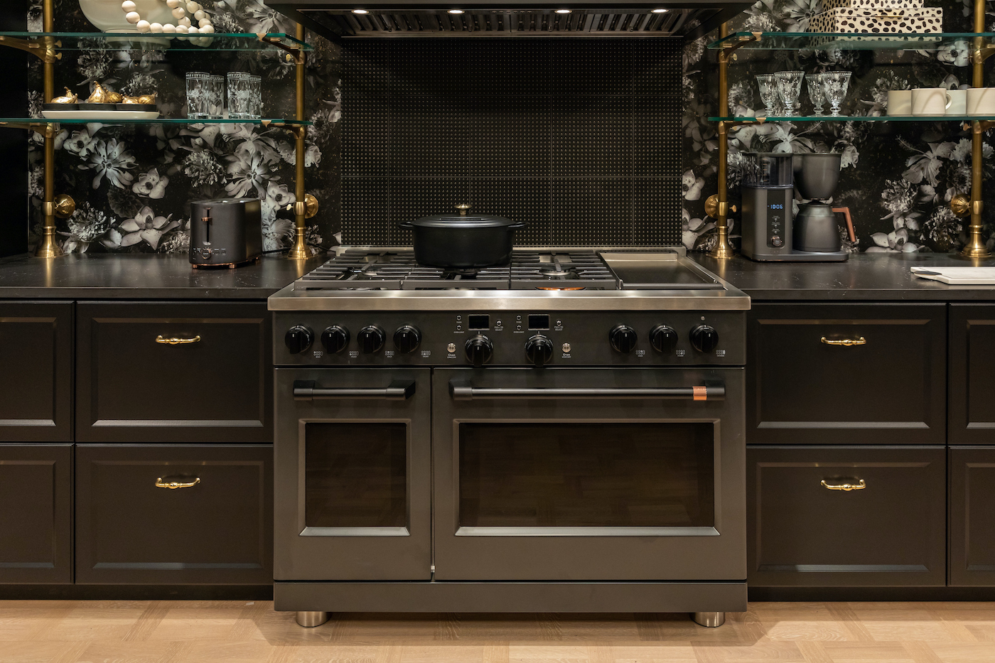 High end kitchen on display with a Le Creuset pot on a CAFÉ oven