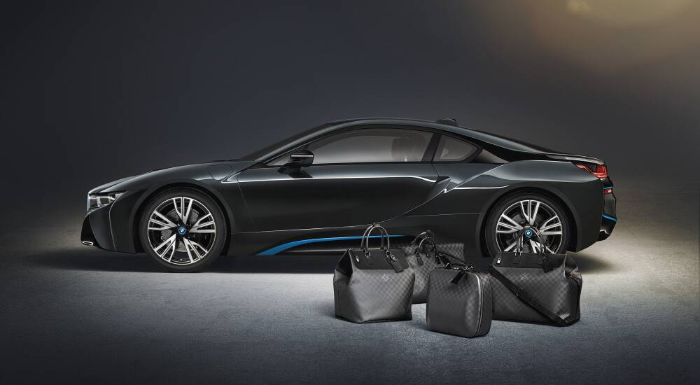 BMW sports car with co-branded luggage by Louis Vuitton