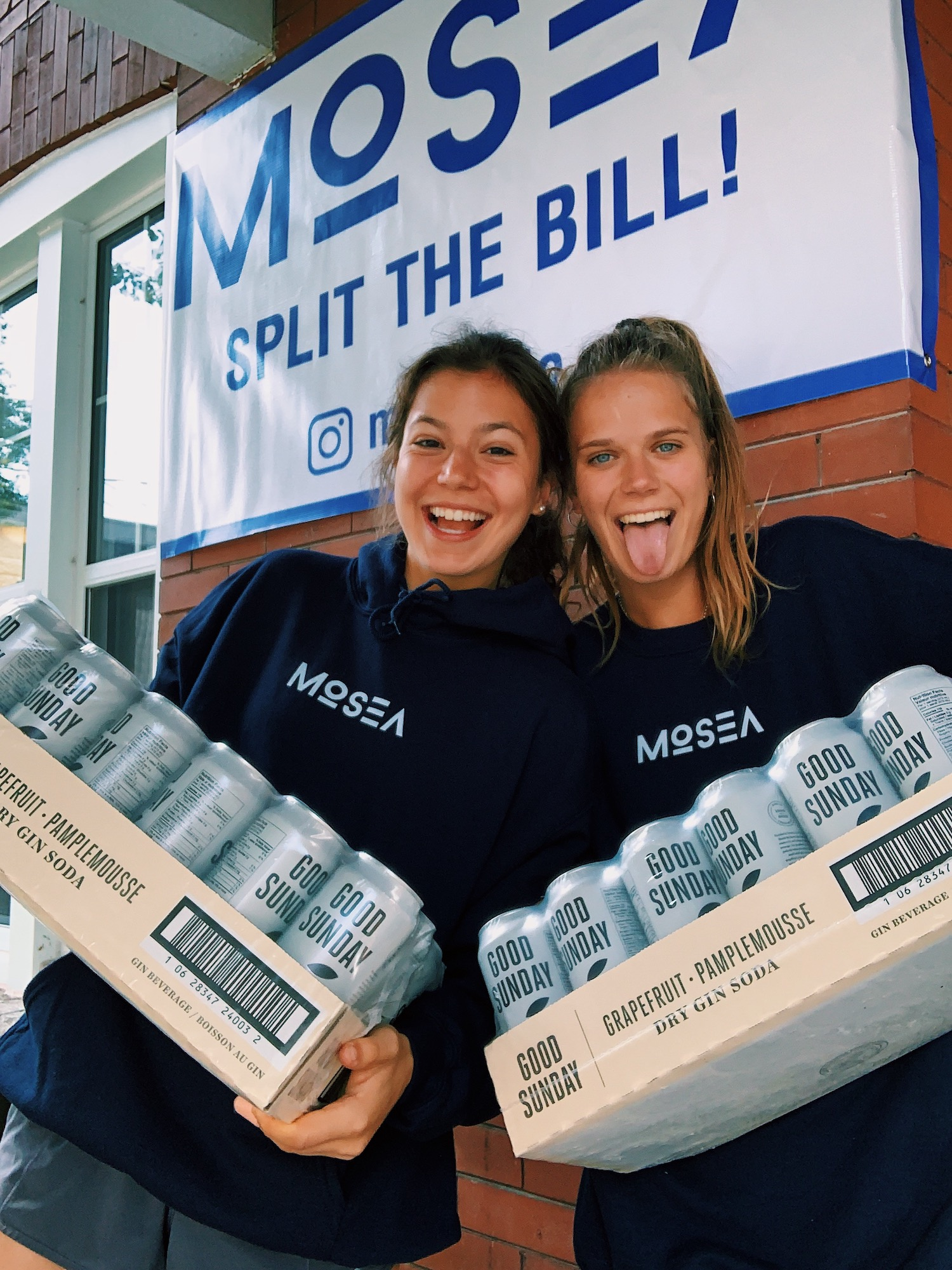 Mosea team members carrying cases of Good Sunday cans