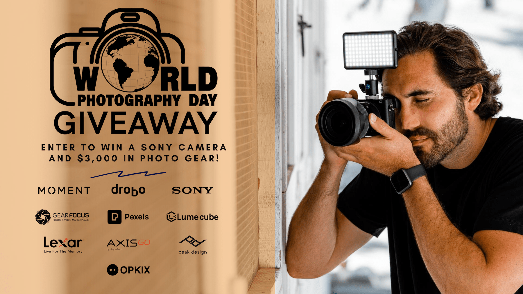 Photographer holding a camera to his face as part of a giveaway collaboration between OPKIX, Lume Cube, Sony & others