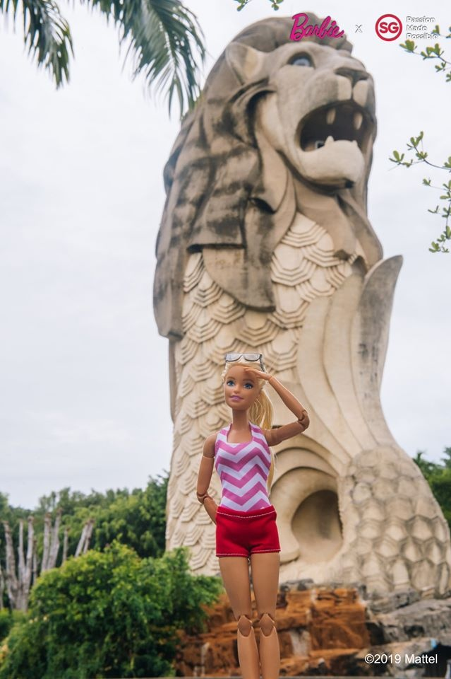 Barbie doll standing in front of Merlion in Singapore
