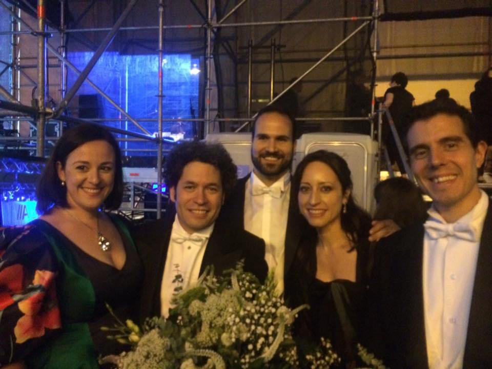 Lidia Vinyes Curtis with Gustavo Dudamel and team outside