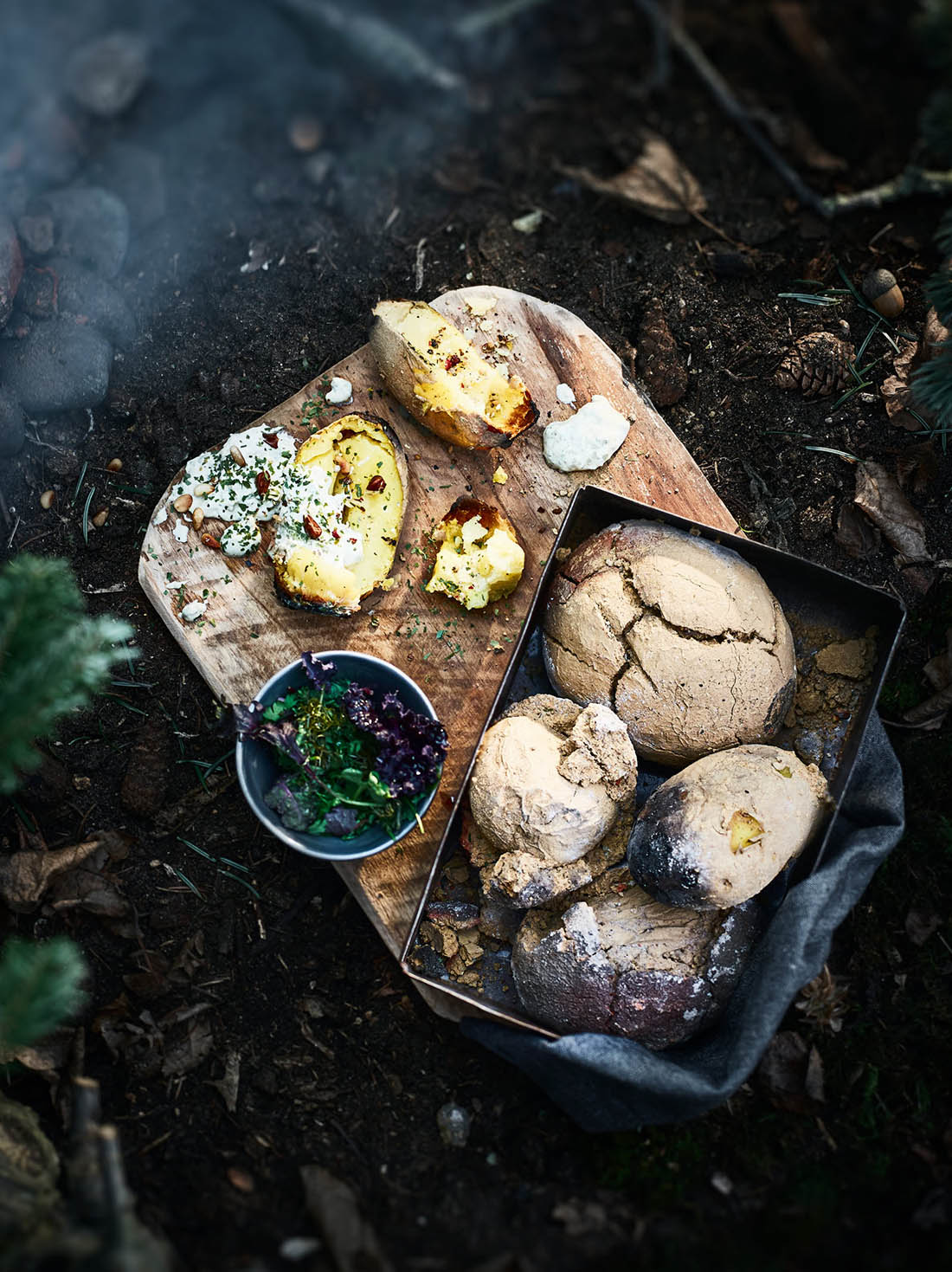 Potatoes made in the clay oven with a curd cheese with herbs sides dishes Food editorial shooting forest ingredients studio Julia Ewers food styling Philipp Burkart Photographer Hamburg