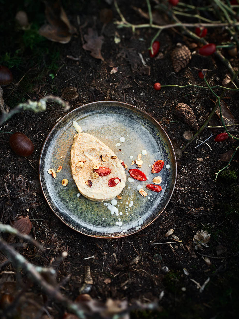 Chestnut mousse with berries and roasted nuts dessert Food editorial shooting forest ingredients studio Julia Ewers food styling Philipp Burkart Photographer Hamburg