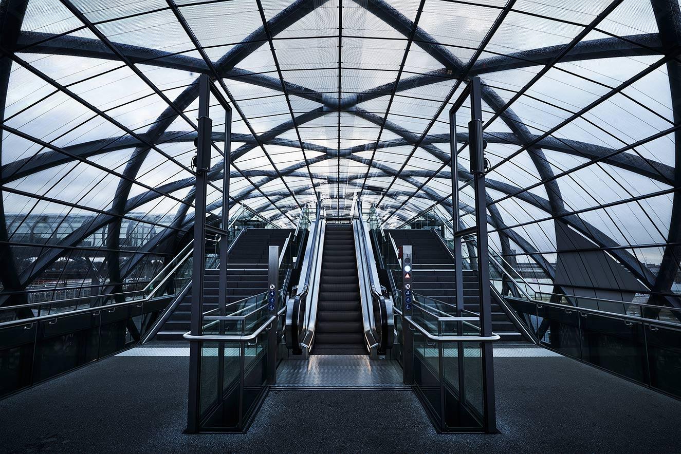 Train station Elbbruecken Moving stairs under a glass roof Architecture street art photography elbbrücken Hamburg Philipp Burkart young photographer Hamburg