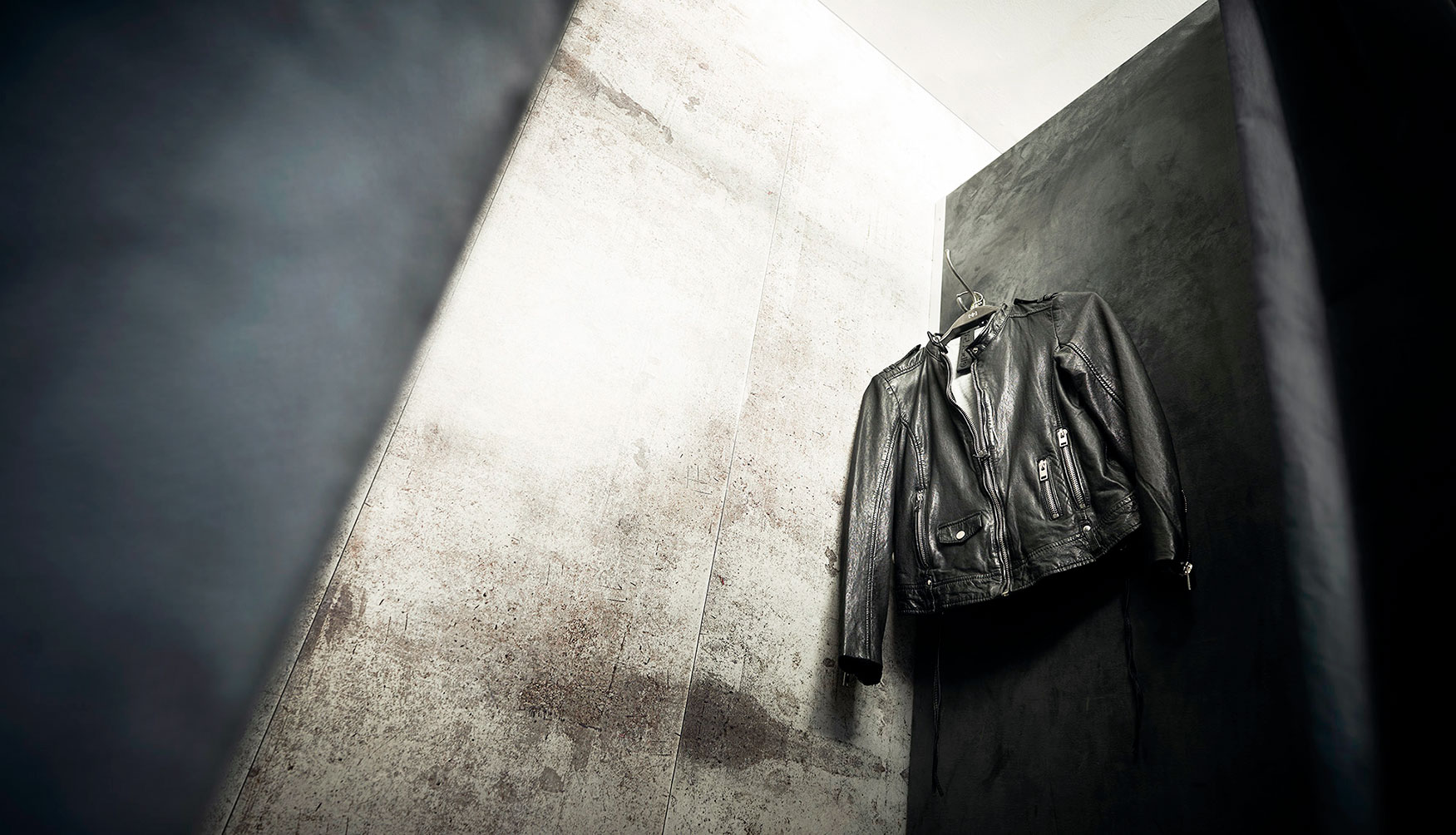 Leather jacket hanging in a changing room in the store duke and lyle fashion product commercial photography Hamburg Philipp Burkart young photographer