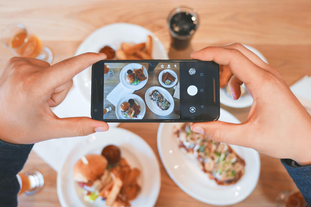 Blogger taking photo of homemade meal planned dinners