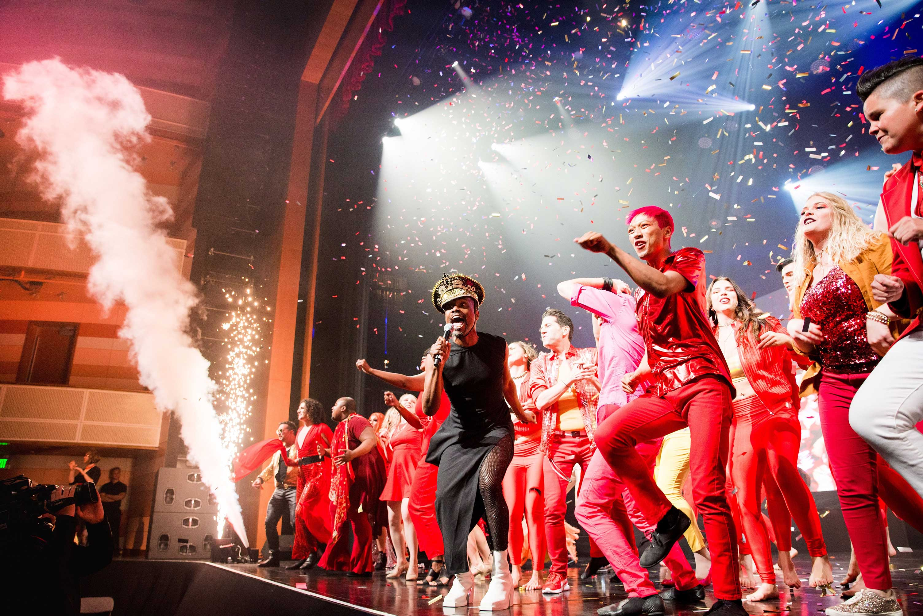 Photo of Billy Porter performing on stage during the 2019 Allies Gala alongside community performers