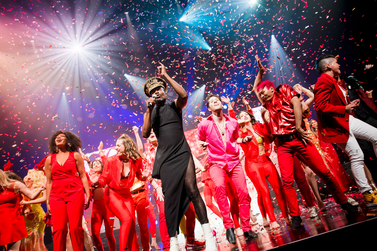 Billy Porter performing on stage during the 2019 Allies Gala alongside community performers