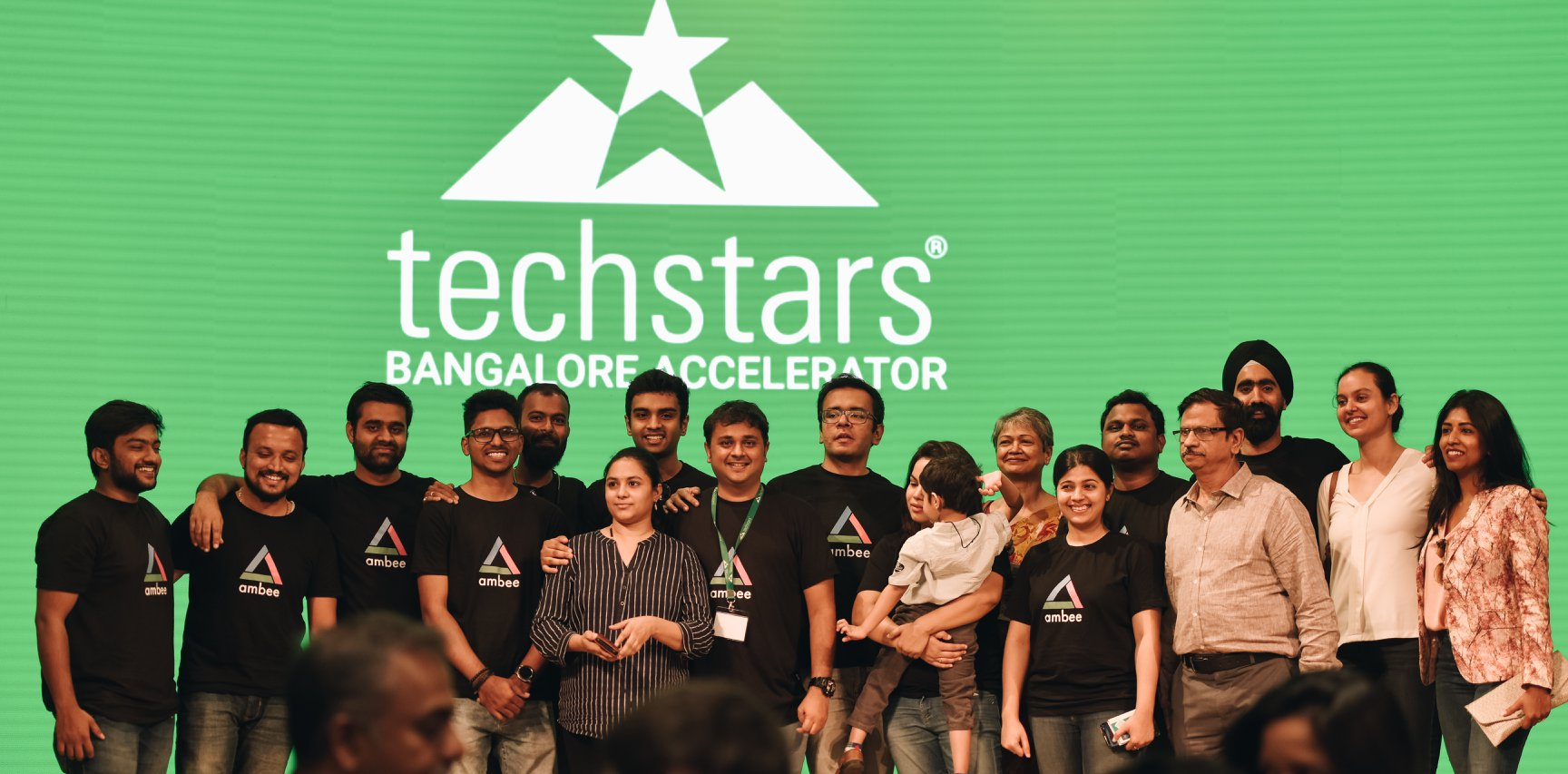 Team Ambee in techstars event standing in the stage