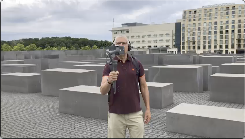 Jeremy Minsberg stands in front of the Memorial to the Murdered Jews while conducting a virtual tour.