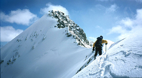 Erik Weihenmayer summiting a mountain