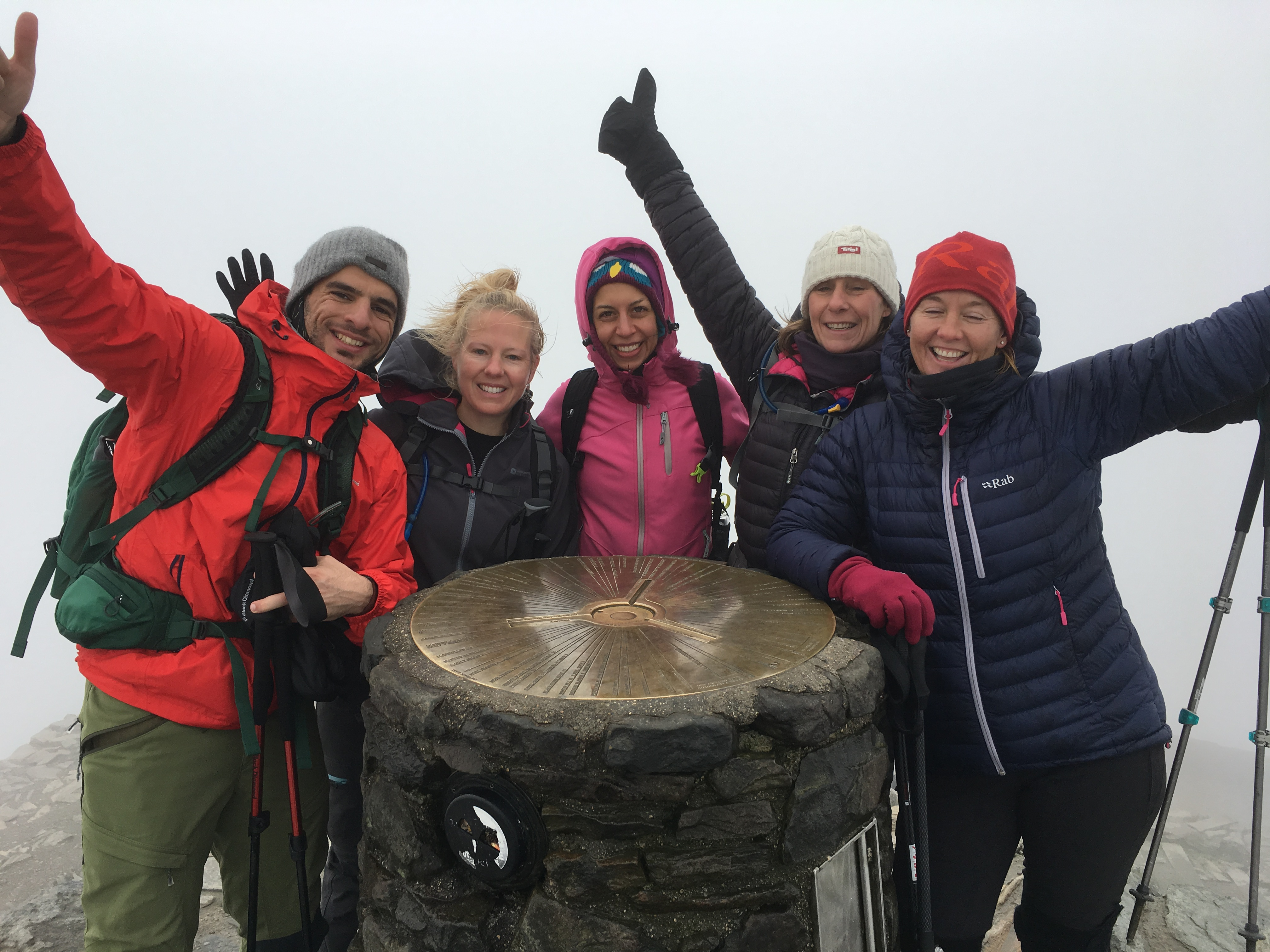 Hikers celebrate finishing the three peaks challeng