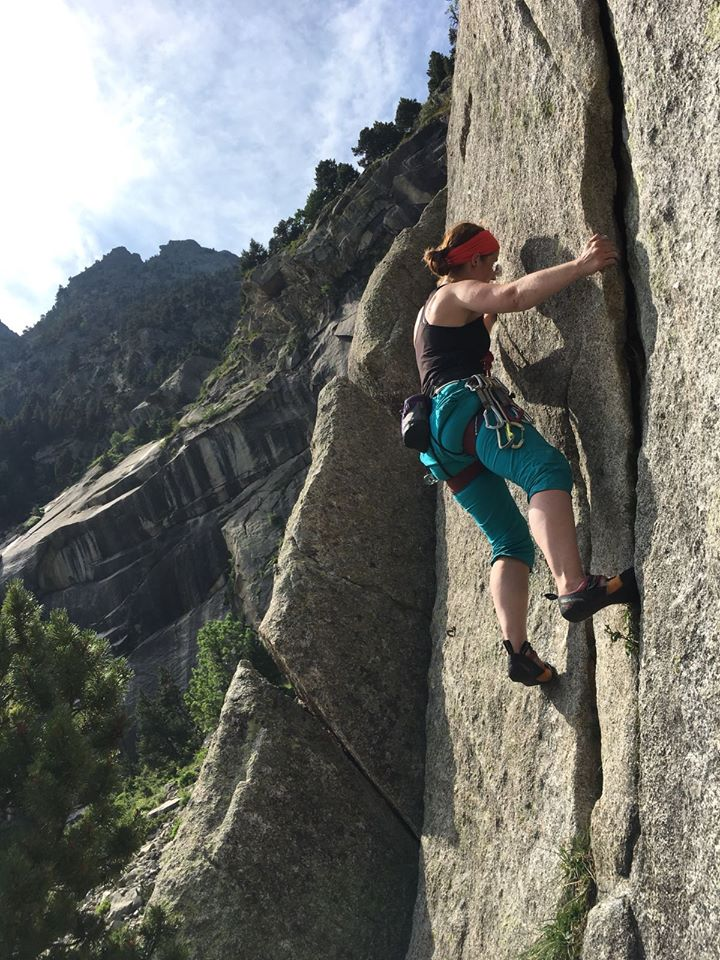 Girl climbs rock face French Pyrenees