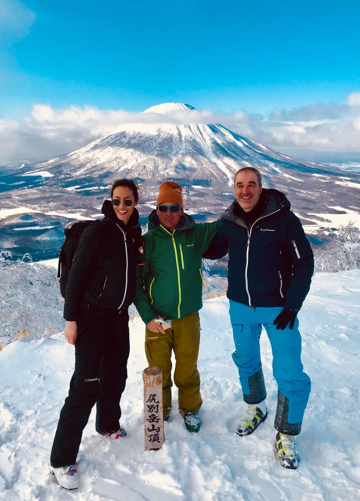 skiers in japan on snowy mountain