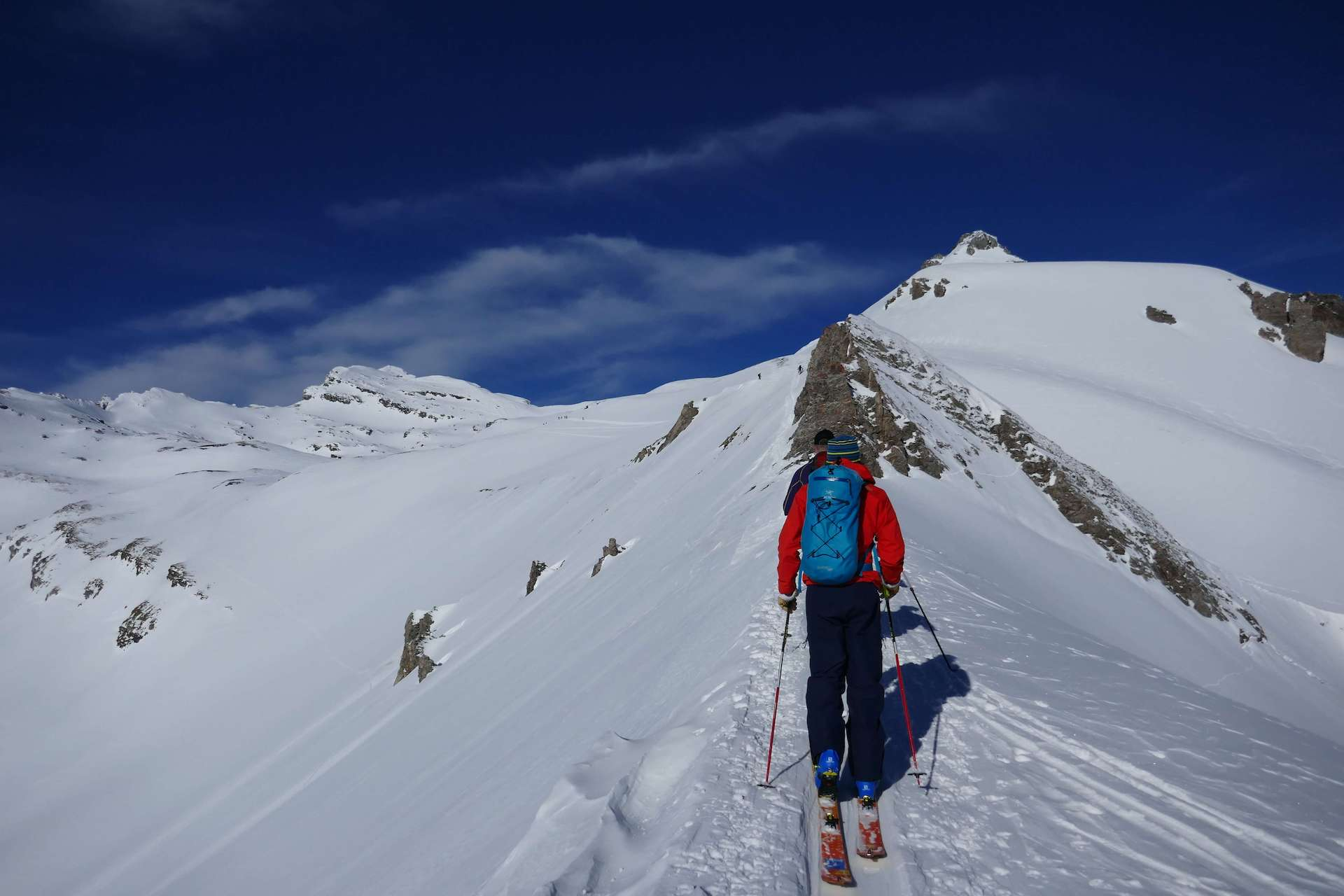 Ski touring snowy mountains in the alps