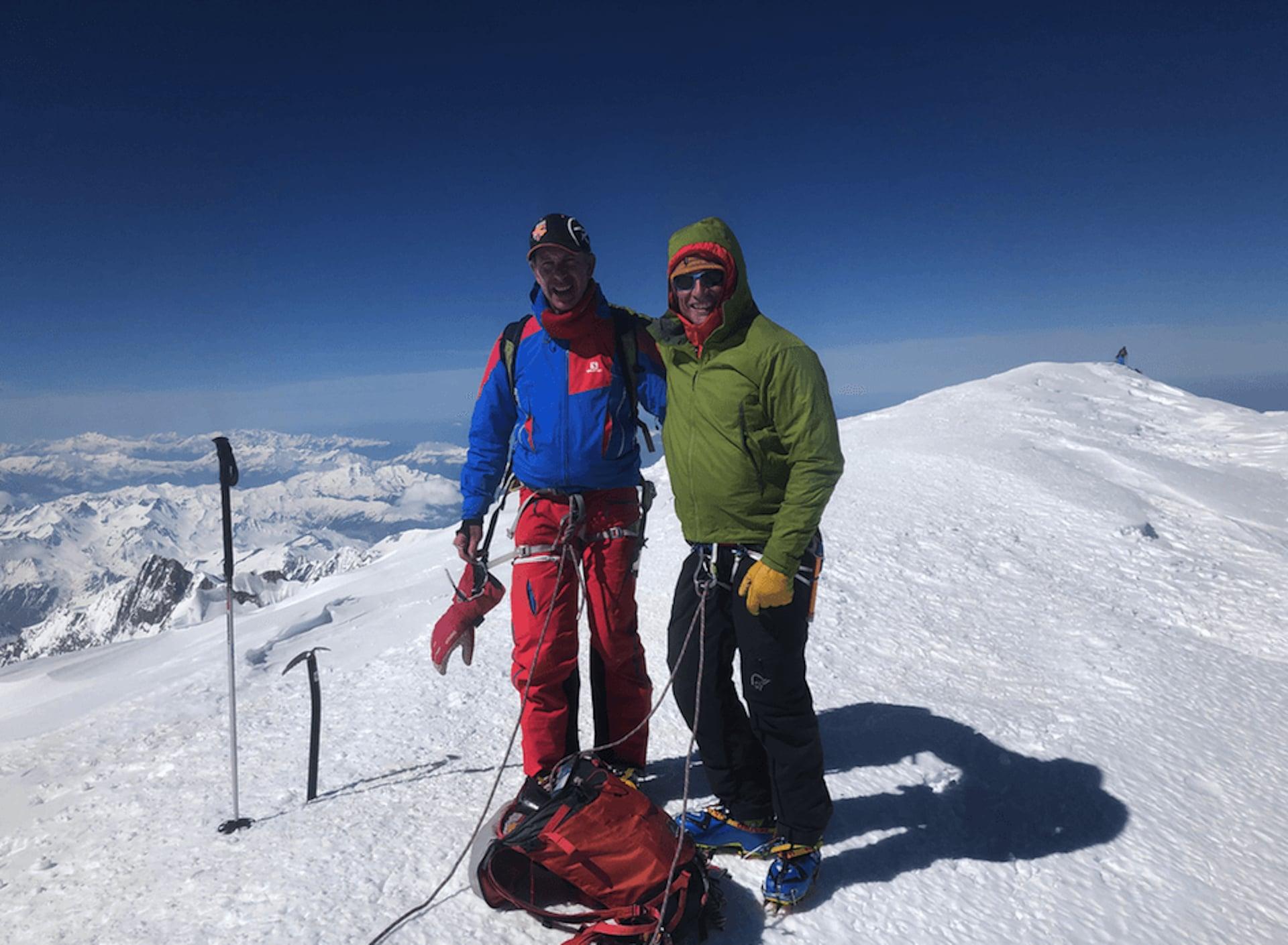 Climbers summit mont blanc