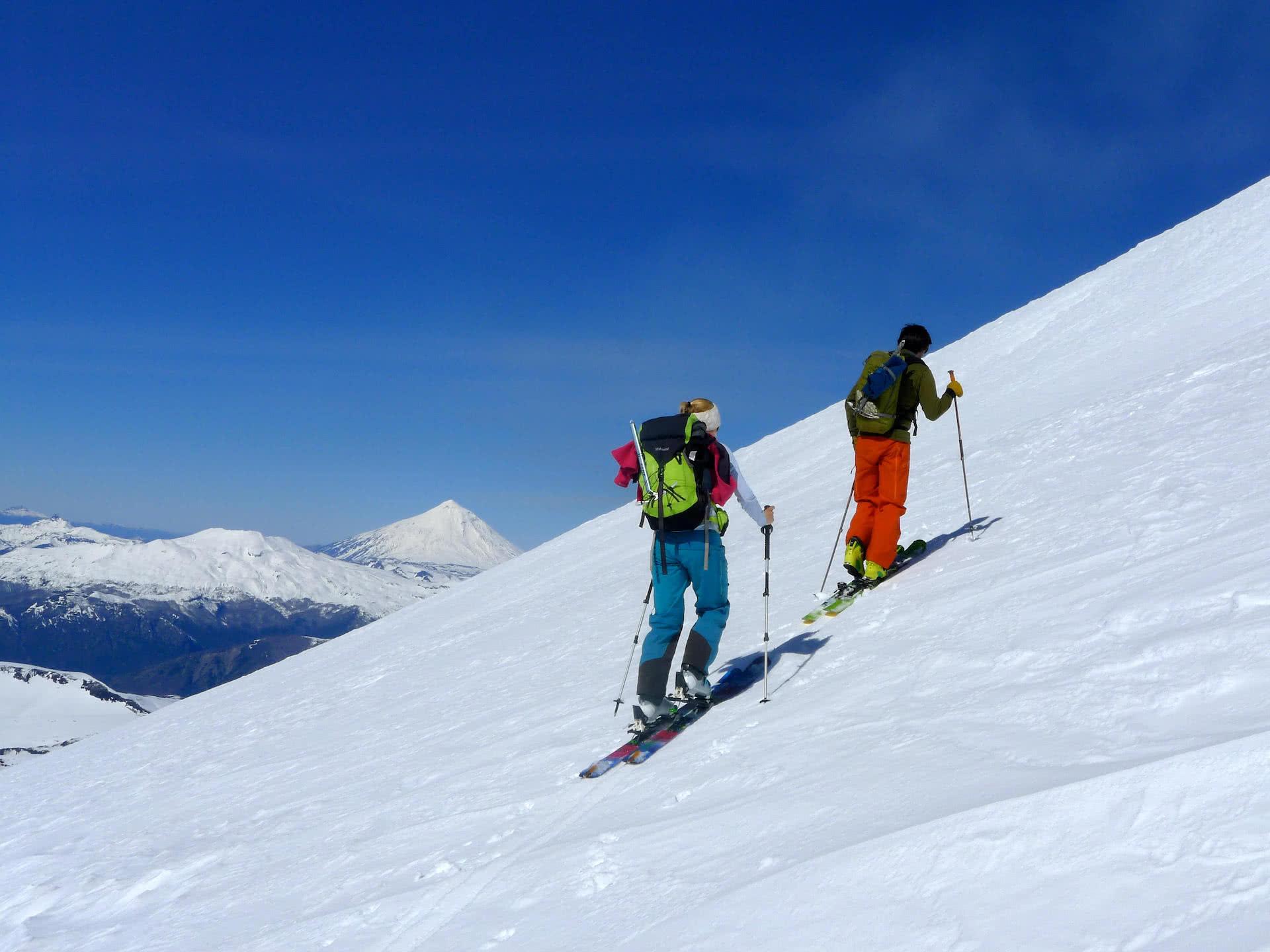 Skinning mountain with snow ski touring