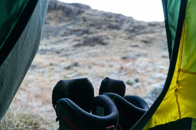 Salomon hiking boots in tent on camping trip
