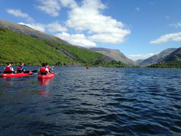 Kayakers paddle llanberis lake snowdonia