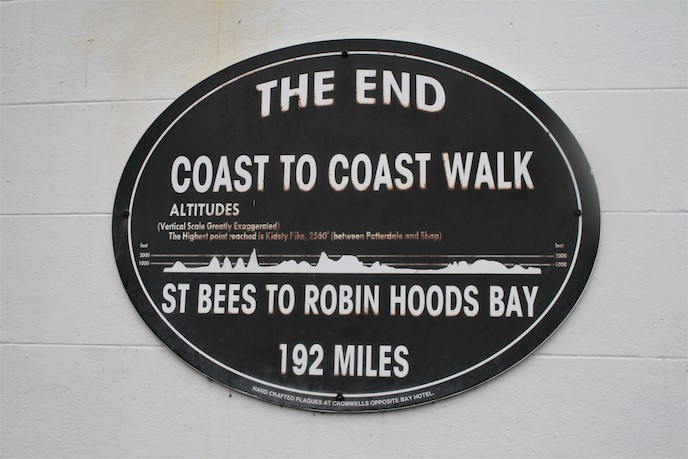 Coast to coast walk st bees to robin hoods bay sign at end of the route