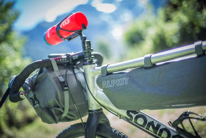 alpkit bikepacking bags top tube and handlebar roll bag on gravel bike