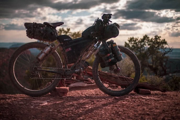 mountain bike with revelate bikepacking bags - seat pack, top tub, frame bag, roll bag