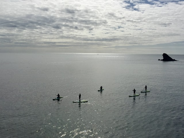 group of paddlers SUP in the sea UK
