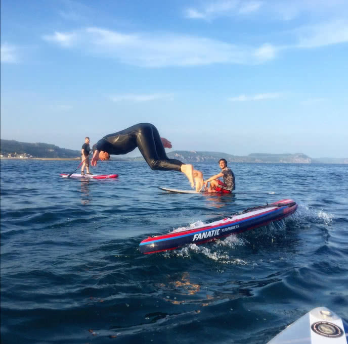 jumping in the water stand up paddle board